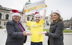 CANCER FUND FOR CHILDREN RECEIVE A GIFT FROM THE BELFAST CHRISTMAS MARKET TRADERS